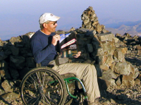 Picture of wheelchair bound mountain climber Four Wheel Bob atop the summit of White Mountain at 14000 feet